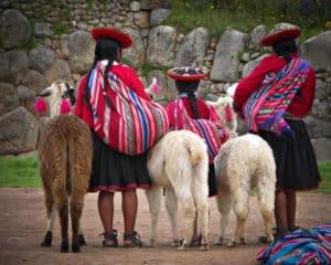 Local Peruvian village people with alpacas