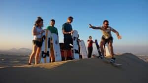 People having fun sandboarding