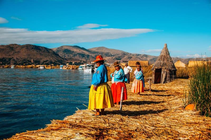 Uros Island locals Lake Titicaca tours Puno Peru Bolivia Border