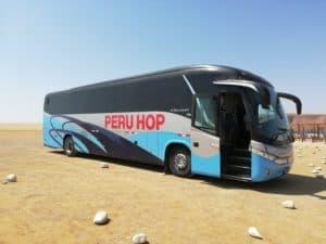 Peru Hop bus stopped door open sunny day desert paracas