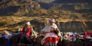women selling their wares in peru